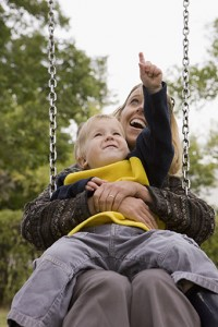 Mother and son on a swing